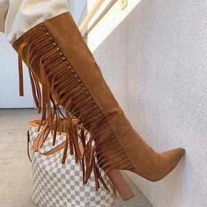 Side fringe heeled boot